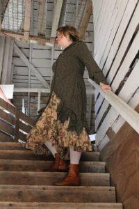 Karen wears her bespoke Hambledon Duster Coat and Anabel Frock.