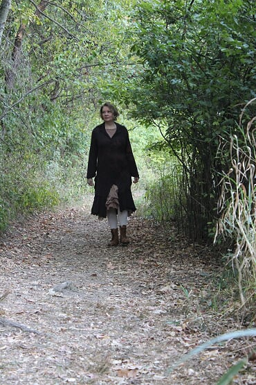 Karen wears her Ivey Abitz Hambledon Duster Coat and Fennefleur Frock on a walk.