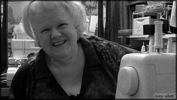 Kaye, an Ivey Abitz master seamstress, at her sewing machine