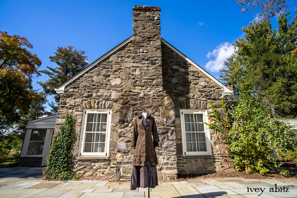 Hudson Duster Coat in Peace Soft Pinstripe Cotton; Hudson Frock in Civility Soft Check Twill; Porte Cochere Sash in Civility Floral Stretch Weave. Location: East profile of Stone Cottage. Eleanor Roosevelt National Historic Site. Val-Kill, Hyde Park, New York.
